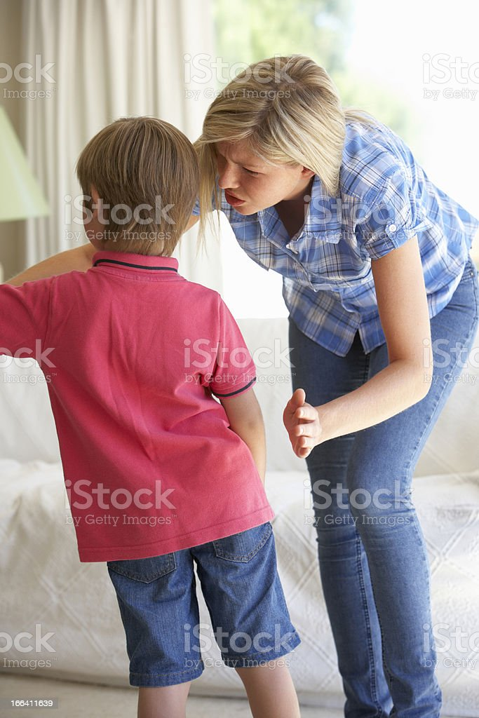 Mother Telling Off Son At Home royalty-free stock photo