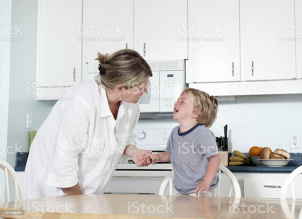 Mother trying to calm crying child at home royalty-free stock photo