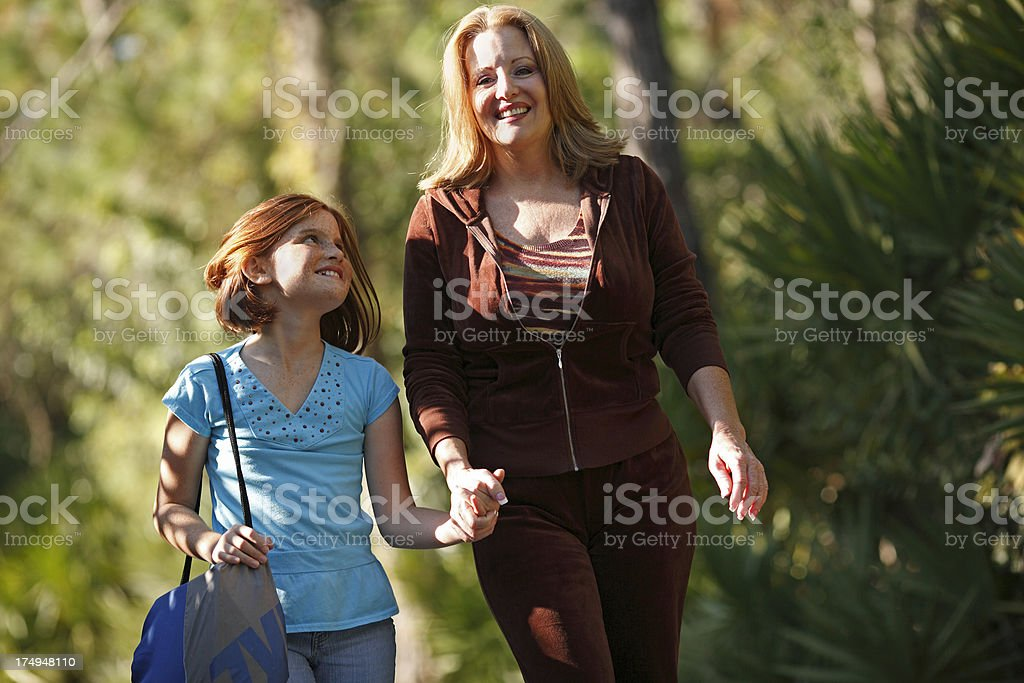 Mother walking daughter to school royalty-free stock photo