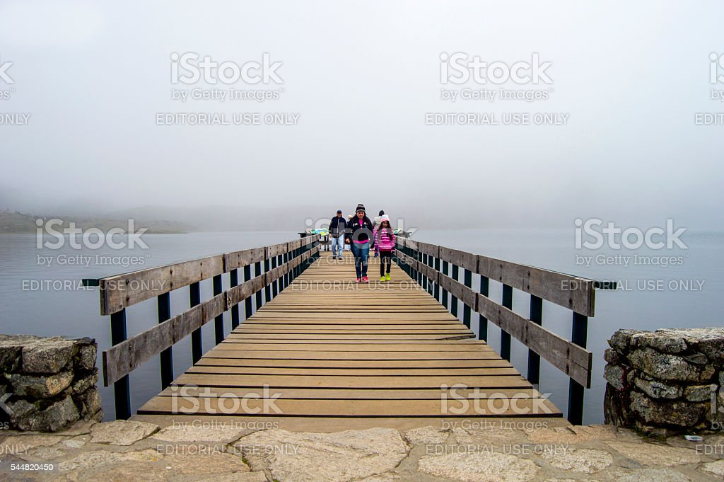 Mother walking with his girl on the bridge stock photo