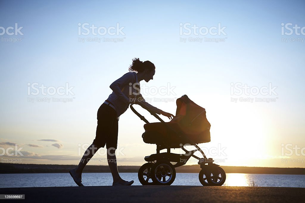 Mother with a stroller stock photo