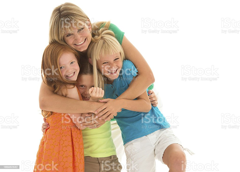 Mother with adorable primary school aged girls stock photo