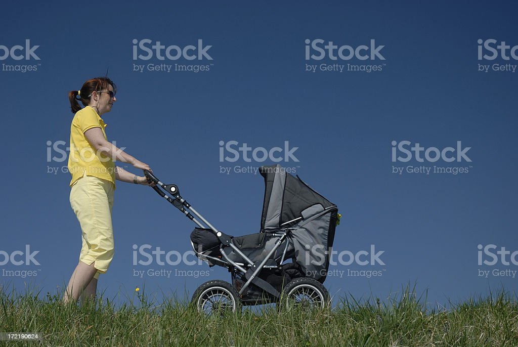 mother with baby carriage royalty-free stock photo