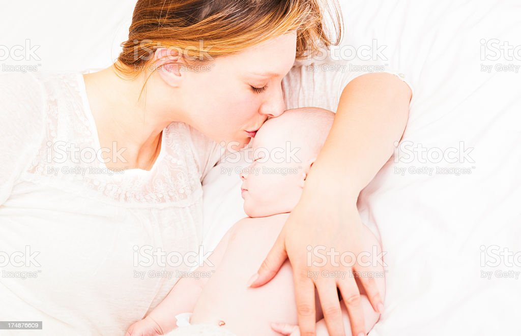 Mother With Baby In Bed royalty-free stock photo