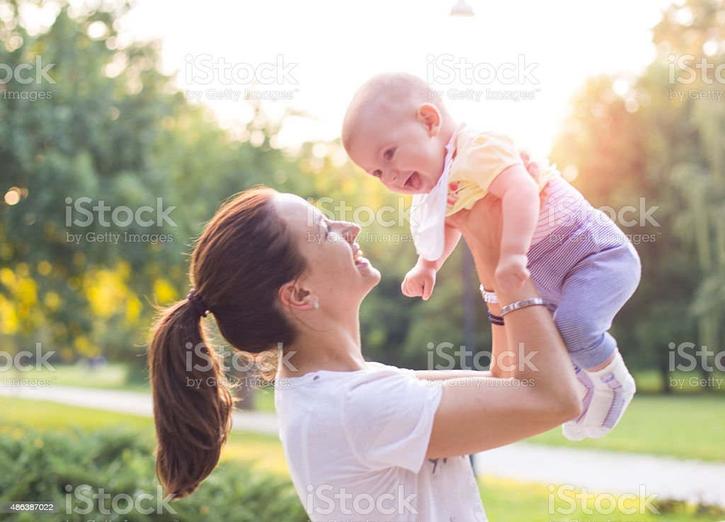 mother with baby in the park stock photo