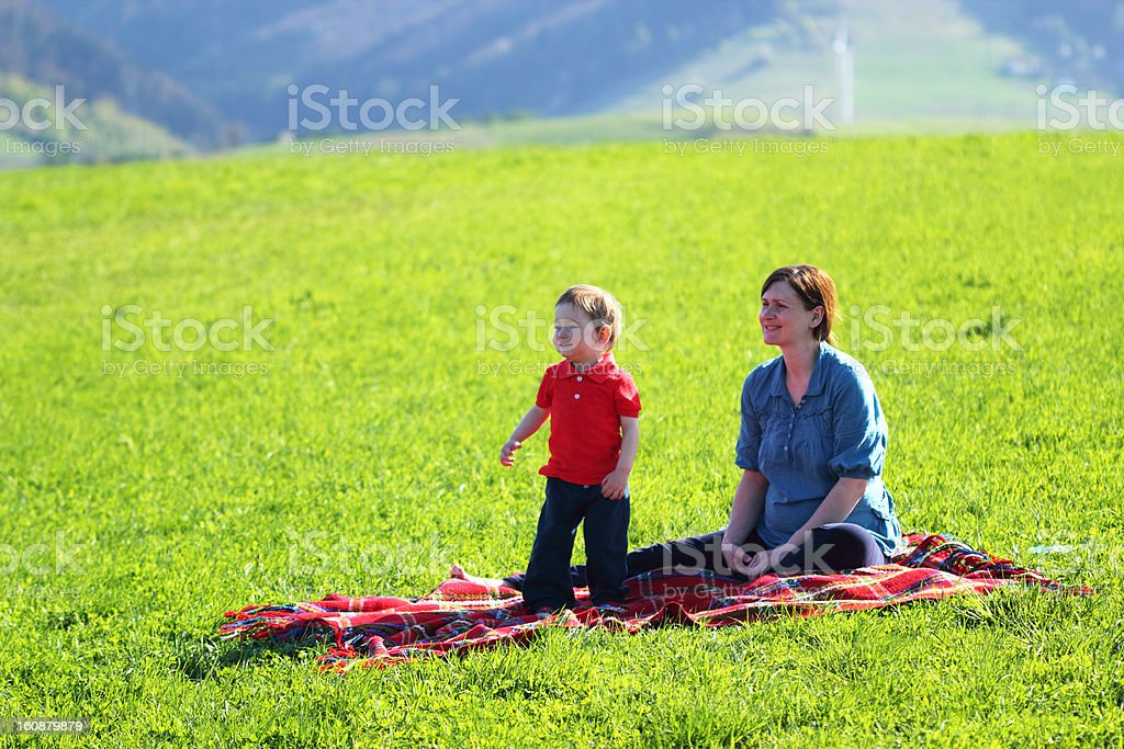 Mother with baby - Leisure in the mountains at sunset royalty-free stock photo