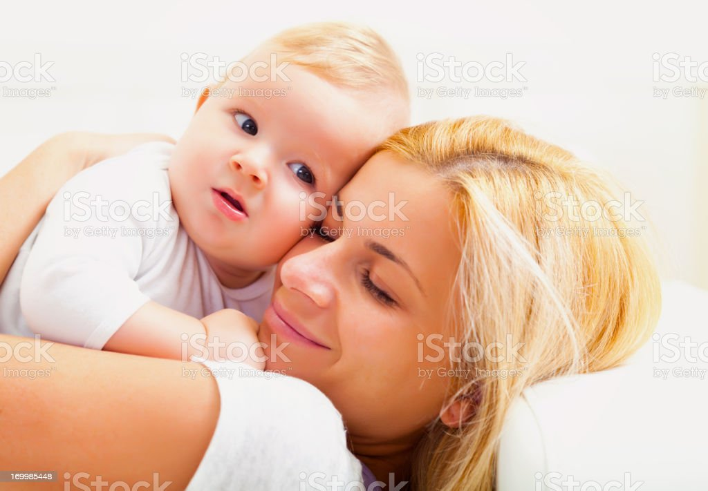 Mother with baby on the couch stock photo