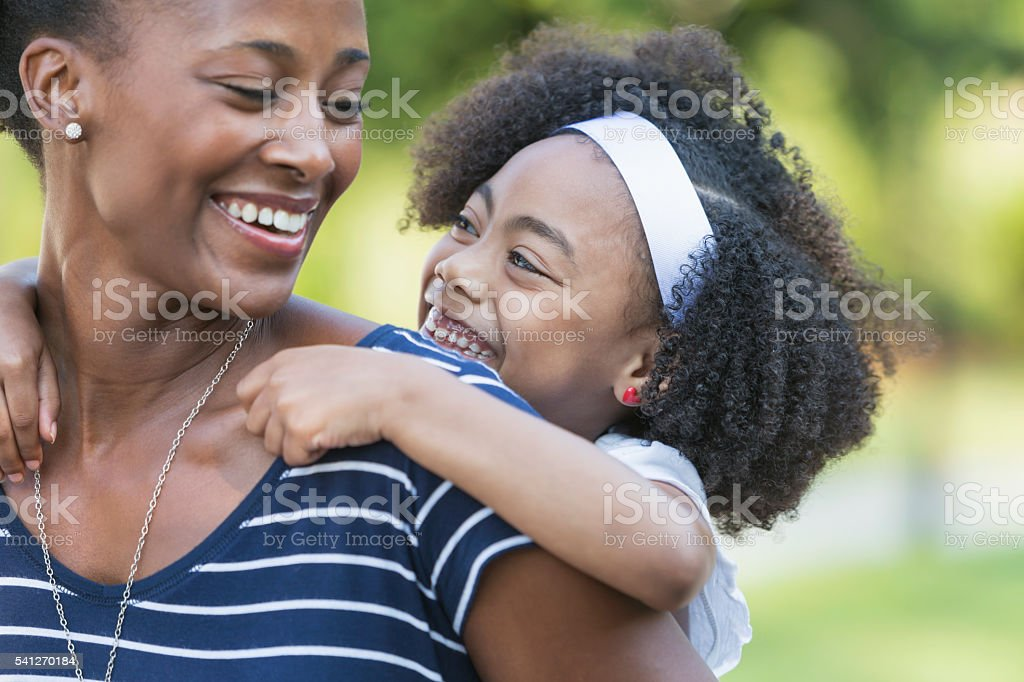 Mother with beautiful mixed race young daughter stock photo