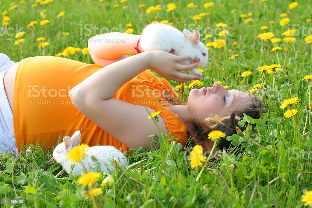 Mother with bunnies stock photo