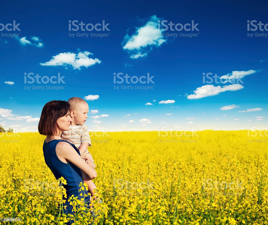 Mother with child in her arms stock photo