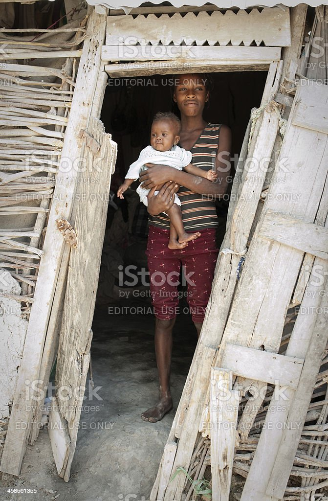 Mother with child in poor house stock photo