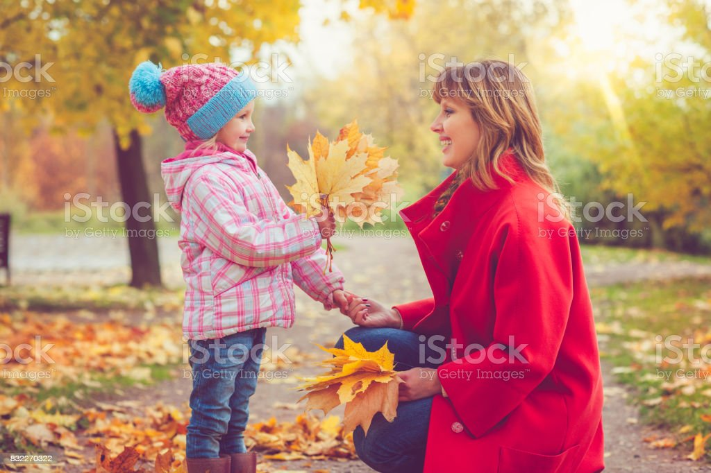 Mother with child outdoors in autumn stock photo