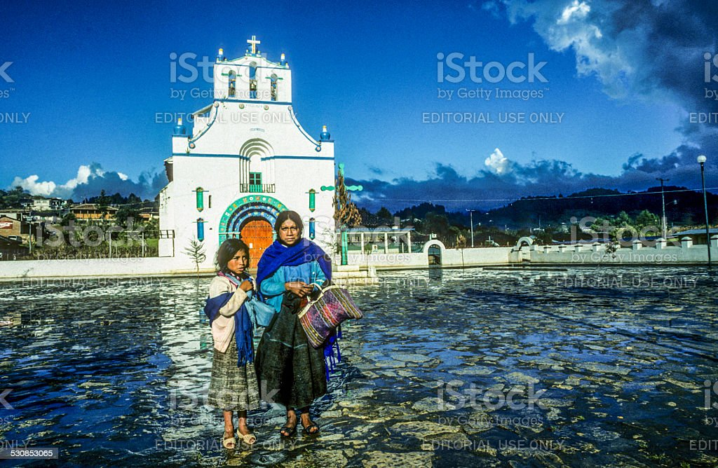 mother with child sells handmade souvenirs stock photo