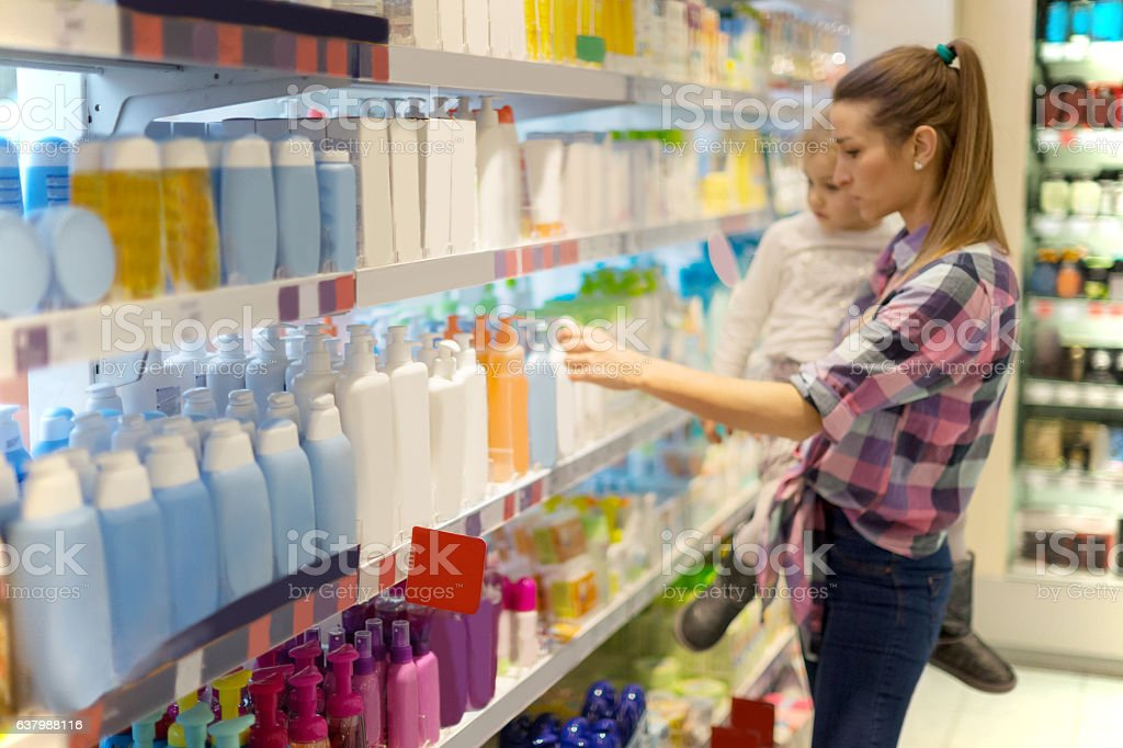 Mother with child shopping for hygiene products stock photo