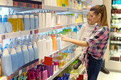 Mother with child shopping for hygiene products