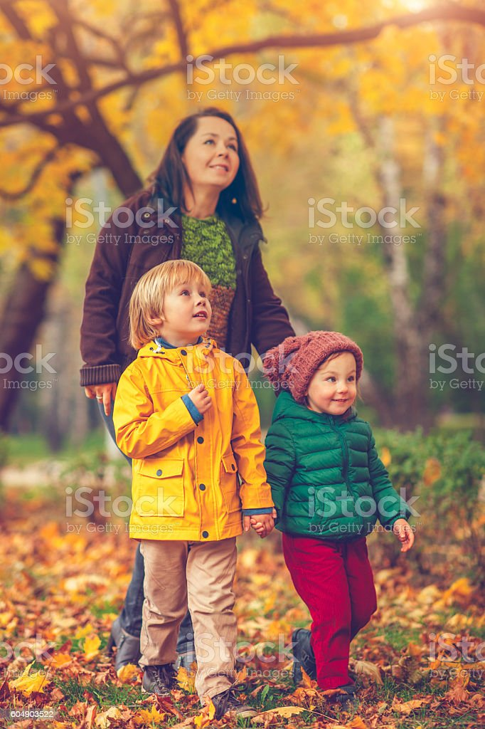 Mother with children in autumn park stock photo