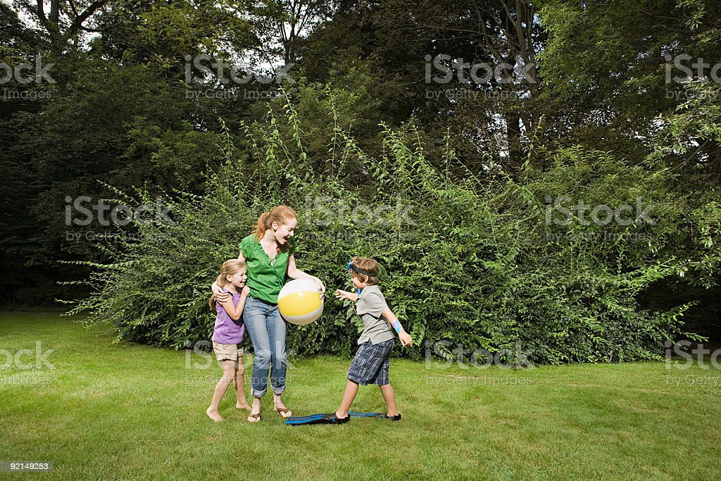 Mother with children in garden royalty-free stock photo