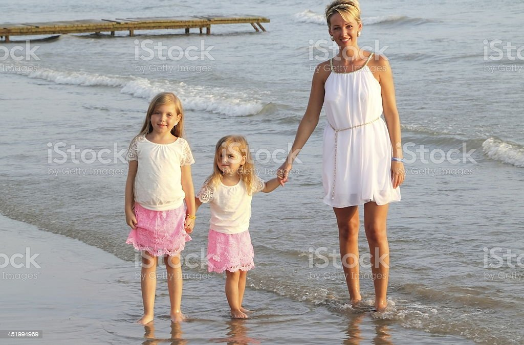mother with children on the beach royalty-free stock photo