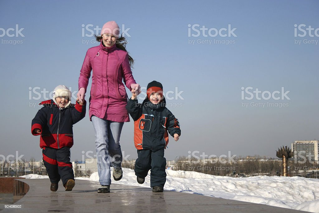 mother with children runnig royalty-free stock photo