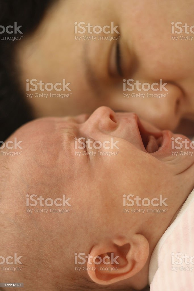 Mother with crying newborn baby royalty-free stock photo