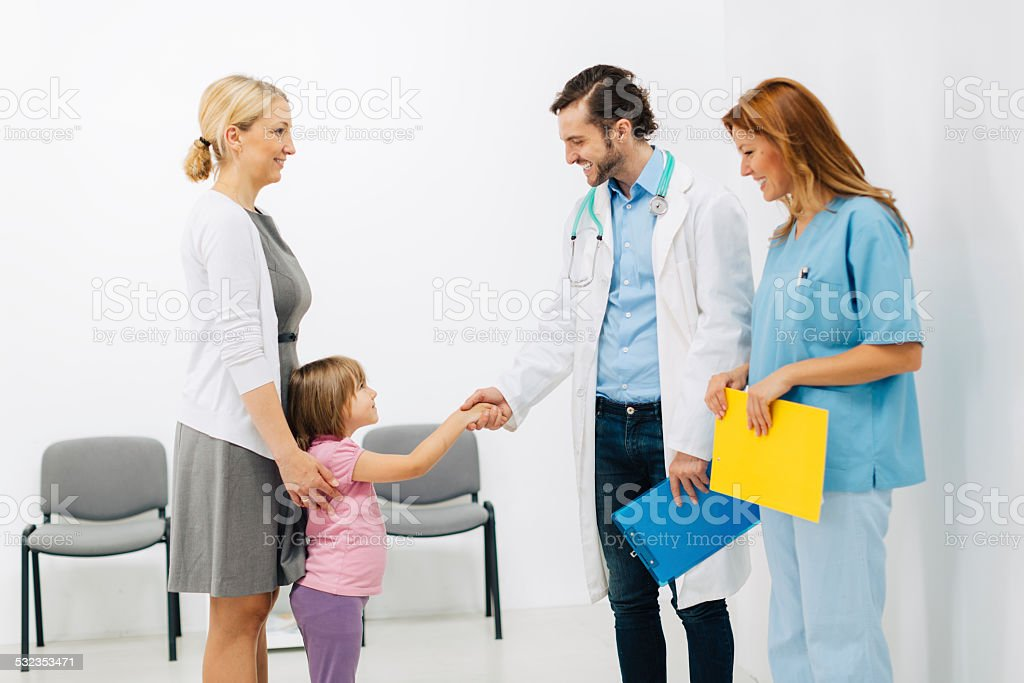 Mother with daughter at doctors office. stock photo