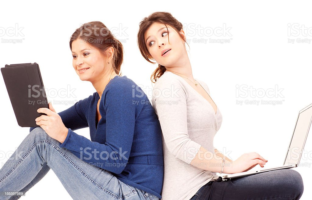 Mother with Daughter using laptop and digital tablet on white royalty-free stock photo