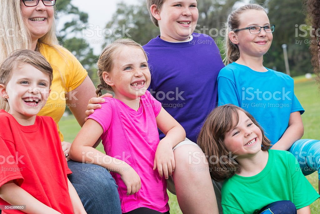 Mother with five children in the park stock photo