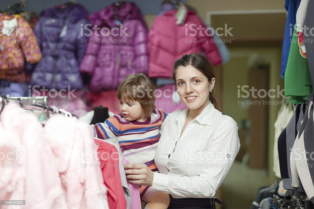 mother with girl at clothes store. Focus on woman royalty-free stock photo