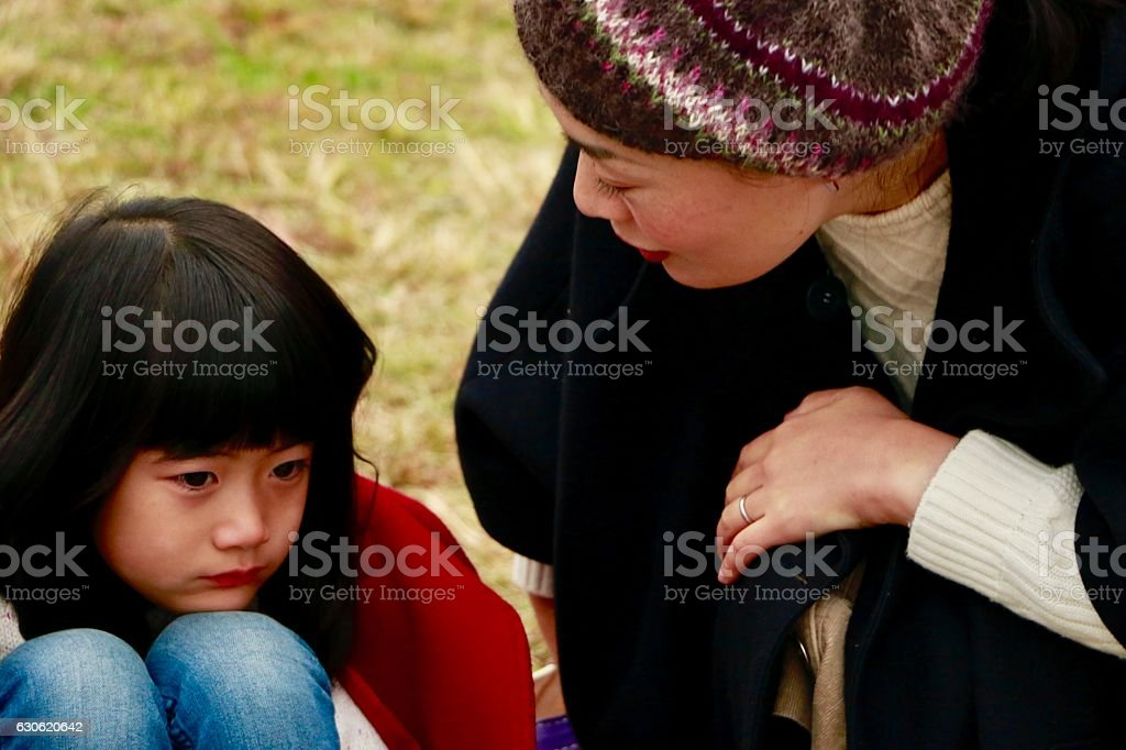 Mother with grumpy daughter stock photo
