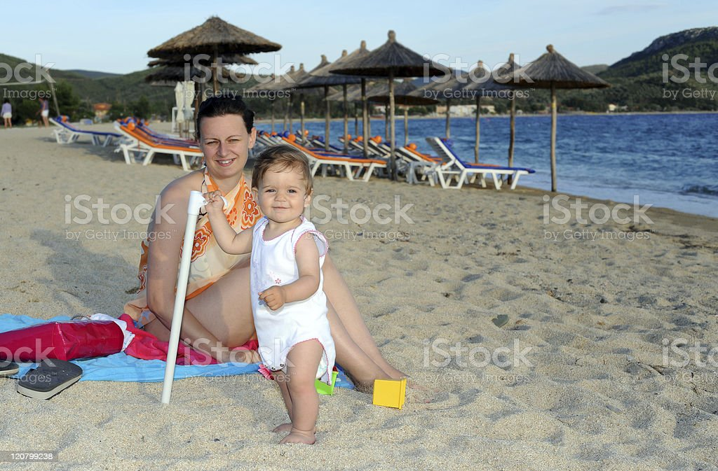 Mother with her baby at beach royalty-free stock photo