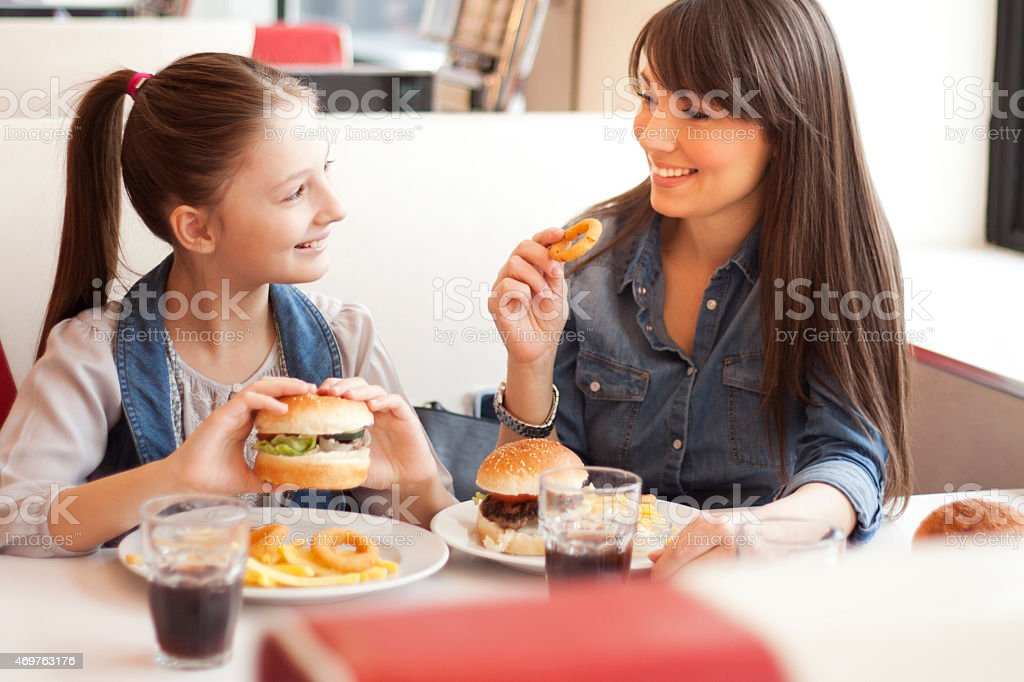 A mother with her daughter at a restaurant stock photo