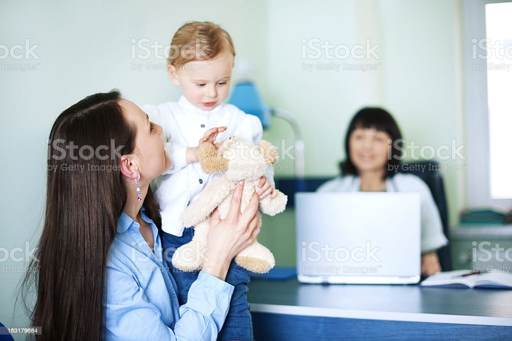 Mother with her daughter at doctors office royalty-free stock photo