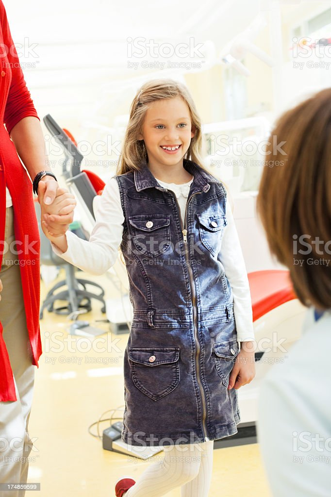 Mother with her daughter at the dentist royalty-free stock photo