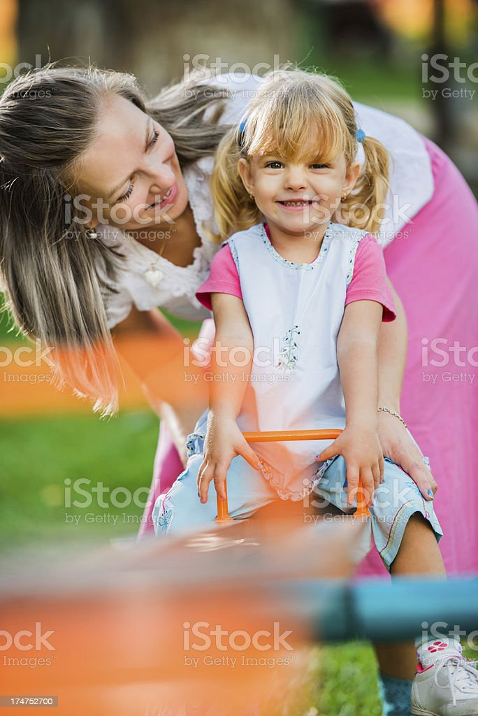 Mother with her daughter enjoying in playground. royalty-free stock photo