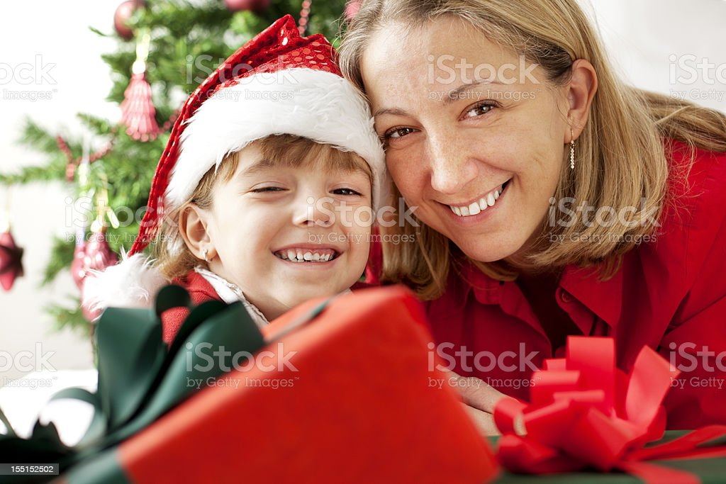 Mother with her little girl enjoy Christmas Holidays royalty-free stock photo