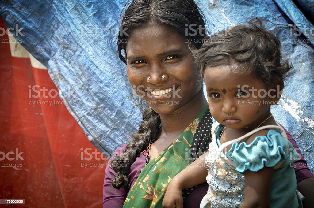 A mother with her little girl on the arm stock photo