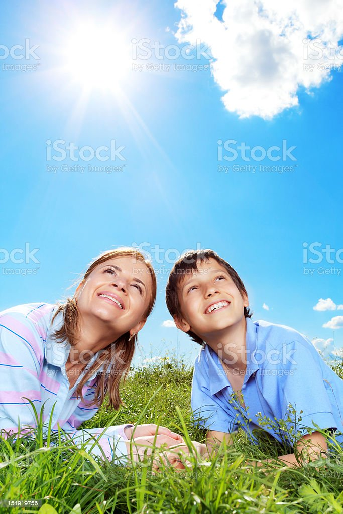 Mother with her son are relaxing against the blue sky. royalty-free stock photo