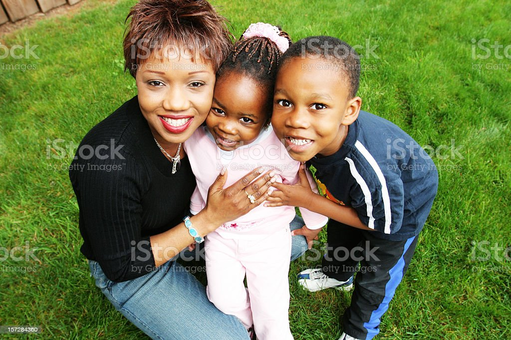 Mother with her Two Children stock photo