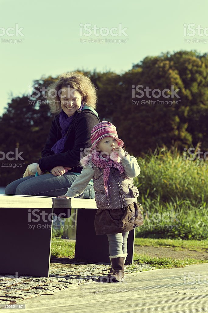Mother with her young daughter at the park royalty-free stock photo