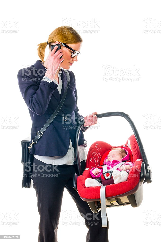 Mother with infant in baby seat stock photo