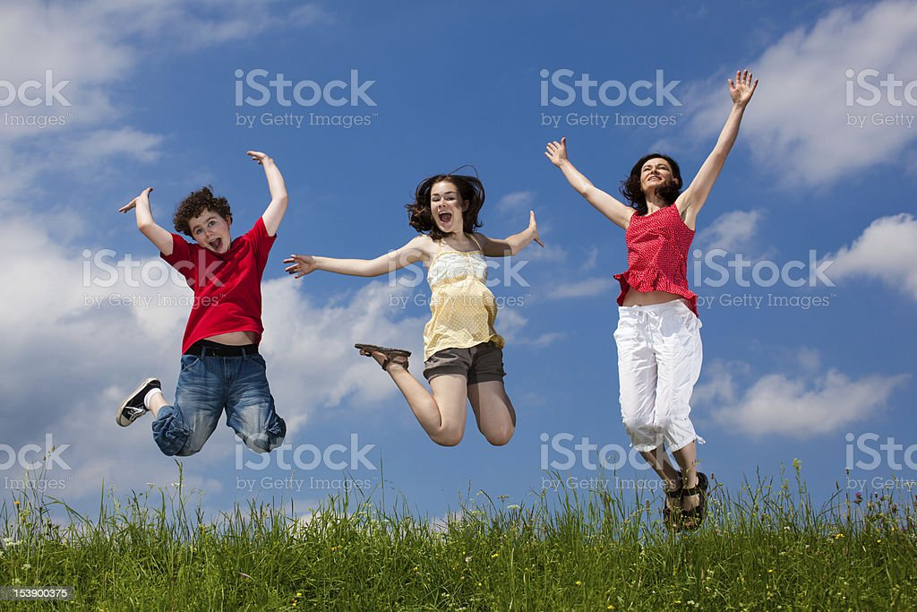 Mother with kids jumping outdoor royalty-free stock photo