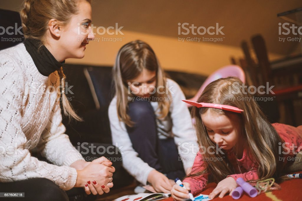Mother with kids painting stock photo
