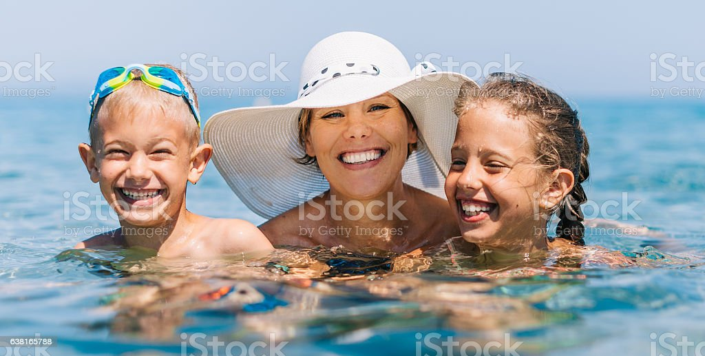 Mother with Kids Vacation Swimming Sea Water Blue Ocean stock photo