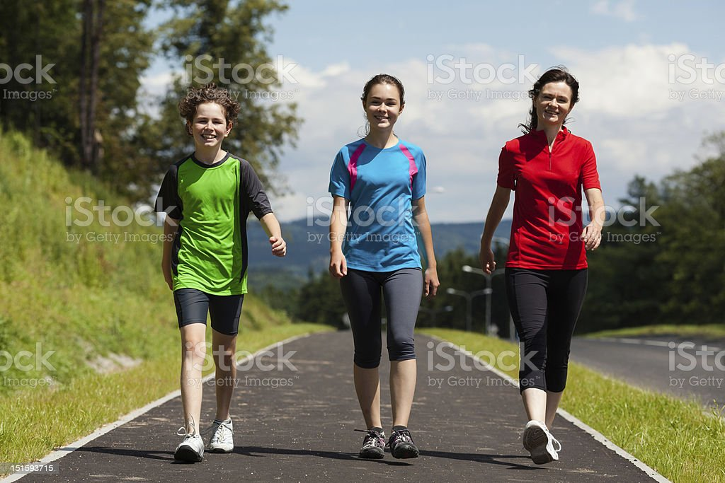 Mother with kids walking outdoor stock photo