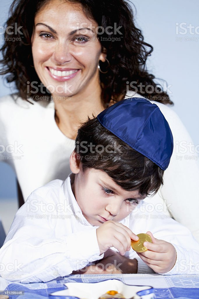 Mother with little boy holding hanukkah gelt stock photo