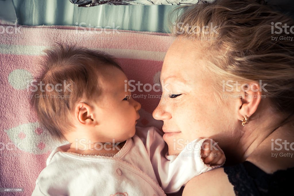 Mother with newborn baby sleeping stock photo