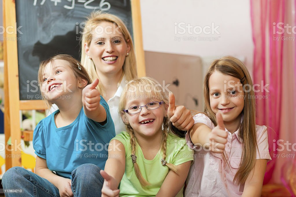 Mother with schoolchildren royalty-free stock photo