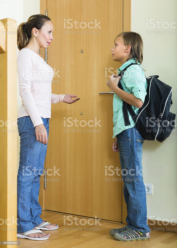 Mother with son at doorway stock photo
