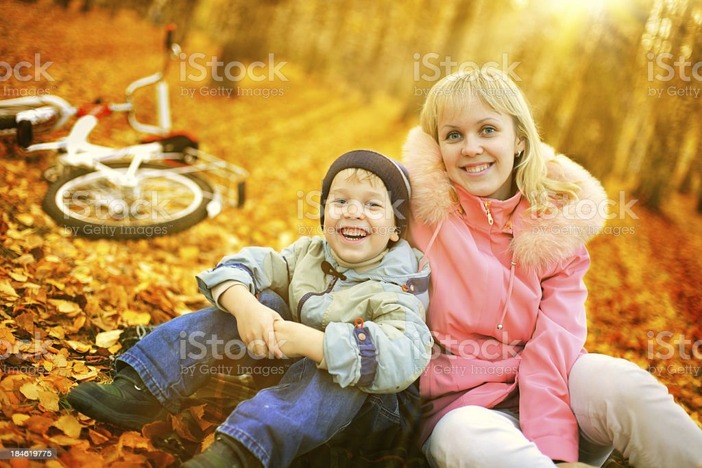 Mother with son in autumn park royalty-free stock photo