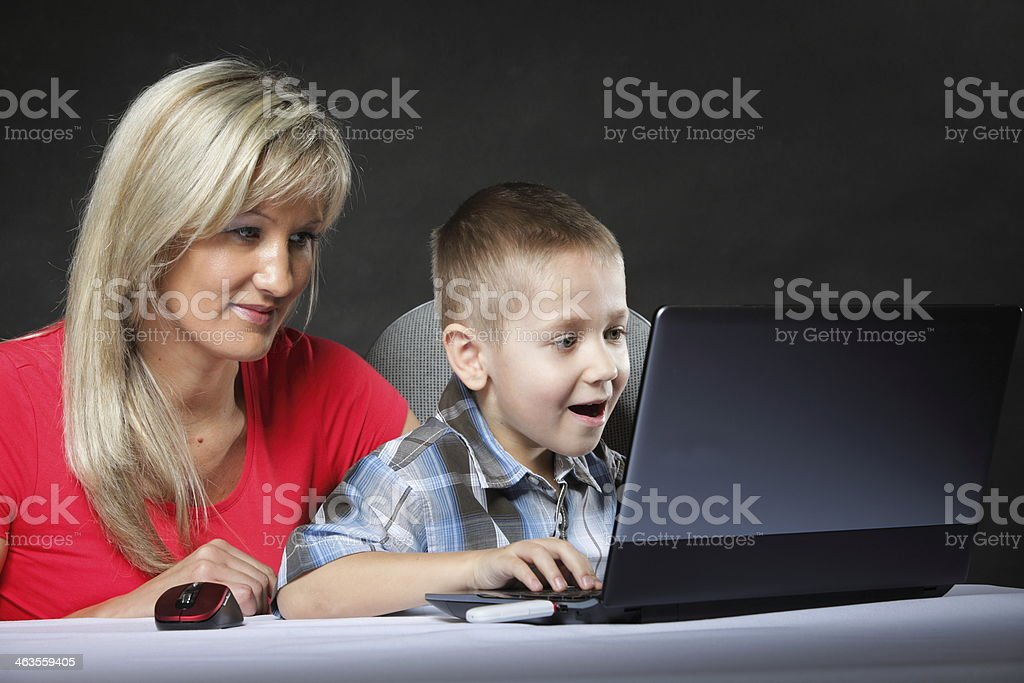 mother with son looking on the laptop royalty-free stock photo